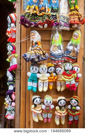Color image of some hand made dolls.