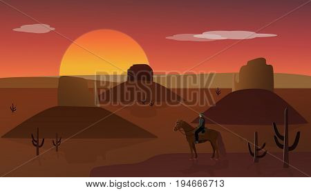 Wild West. Cowboy on horse with view over a wild west landscape with sunset.