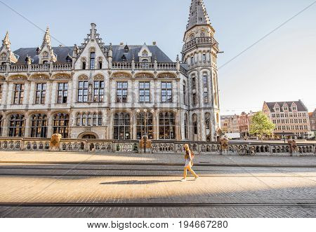 Stret view on the Post office building with woman walking during the morning in Gent city, Belgium