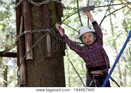 Boy Climbing In Rope Park