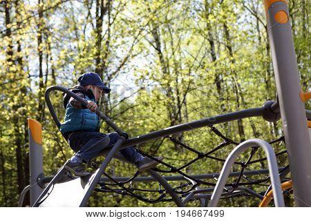 Boy Climbing In Playground