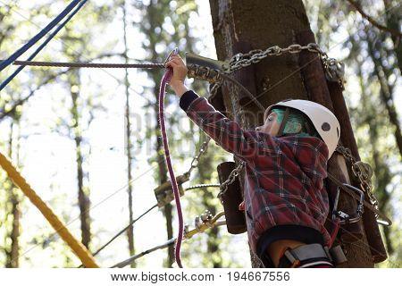 Kid Climbing In Adventure Rope Park
