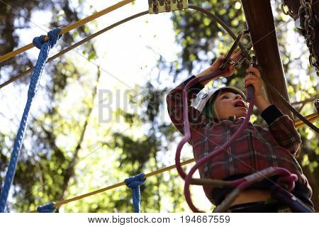 Kid Climbing In Rope Park