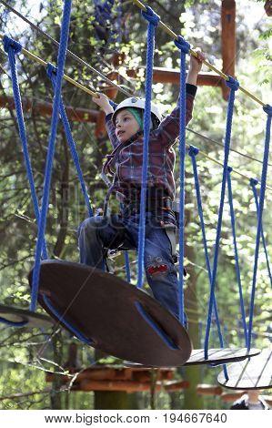 Preschooler Climbing In Rope Park