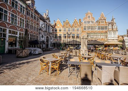View on the square with cafes and restaurants during the morning light in Gent city, Belgium