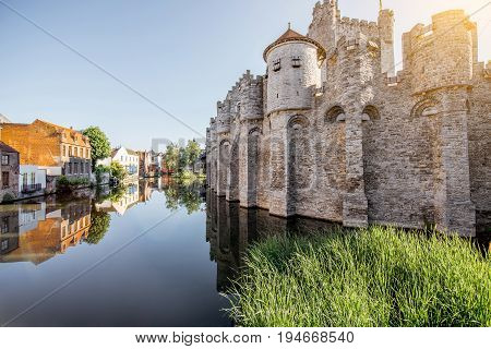 Riverside view with beautiful old buildings and castle walls during the morning light in Gent city, Belgium
