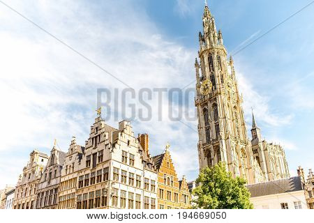 View on the beautiful buildings with the church tower in the center of Antwerpen city in Belgium