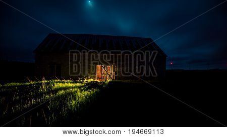 The glow of light from a barn in Prince Edward Island