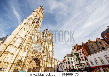 View from below on the Our Lady church in Antwerpen city during the sunset in Belgium