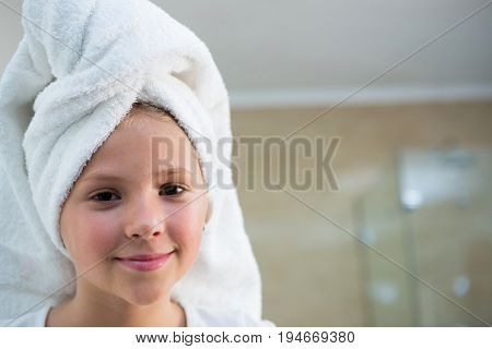 Portrait of girl with hair wrapped in towel bathroom