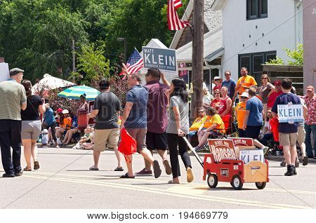 MENDOTA, MN/USA - JULY 8, 2017: Parade on main street of Mendota. The city is one of the first permanent settlements in Minnesota situated near the confluence of the Minnesota and Mississippi Rivers.