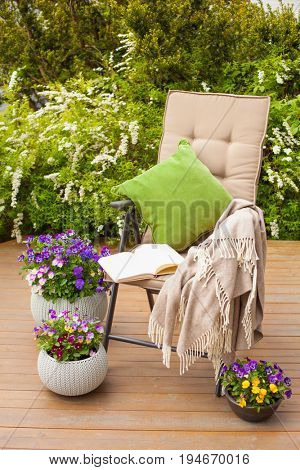 garden chair on terrace, relax, flowers, bush