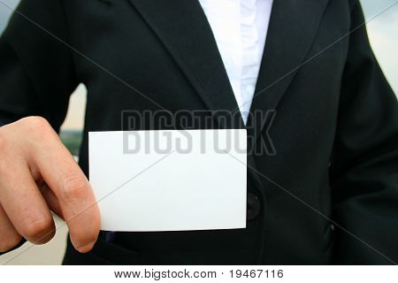 Asian business woman showing card.