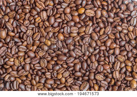 Texture of fried arabica coffee beans. Background.