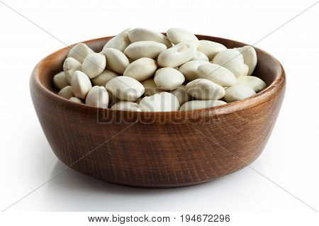 Dry Butter Beans In Dark Wooden Bowl Isolated On White.