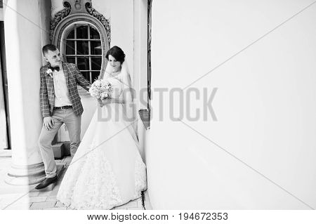 Flawless Wedding Young Couple Walking On City Streets On A Sunny Day. Black And White Photo.