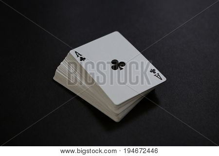 Close-up of card deck on black table