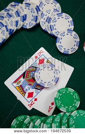 Playing cards and casino chips on poker table in casino