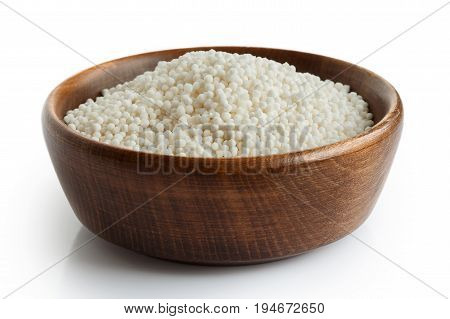 Dry Tapioca Pearls In Dark Wooden Bowl Isolated On White.