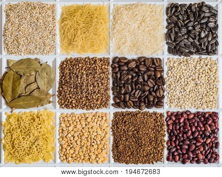 Grocery set of food products: barley grits vermicelli rice sunflower seeds bay leafs buckwheat roasted coffee beans pearl barley figured macaroni dried peas freeze-dried instant coffee dried seeds of beans.