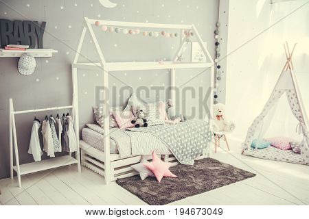 Little princess's room in tender pastel colors with a lot of cute details