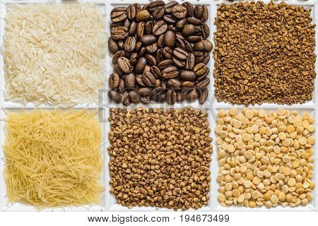 Grocery set of food products: rice roasted coffee beans freeze-dried instant coffee vermicelli buckwheat dried peas.
