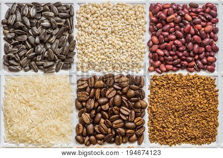 Grocery set of food products: sunflower seeds pearl barley dried seeds of red beans rice roasted coffee beans freeze-dried instant coffee.