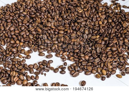 Spilled roasted coffee beans arabica. Agriculture product background.