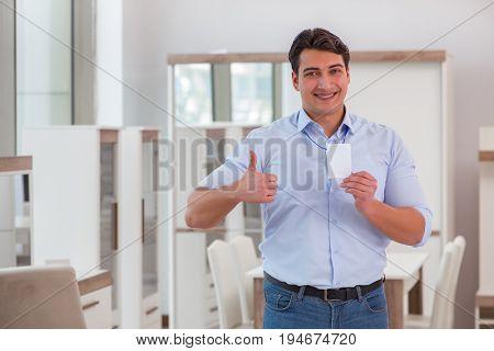 Salesman assistant in furniture shop