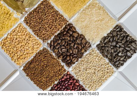 Grocery set of food products: vermicelli rice sunflower seeds bay leafs buckwheat roasted coffee beans pearl barley figured macaroni dried peas freeze-dried instant coffee dried seeds of beans.