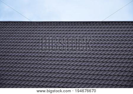 The Texture Of The Roof Of Painted Metal. Close-up Detailed View Of Roof Covering For Pitched Roof.