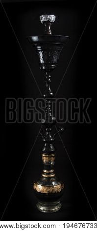 Hookah pipes with black background. Hand Painted Vases and stems made with aluminum, steel, and brass