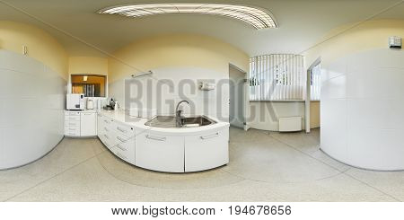 Panorama view of modern interior european dental clinic with equipment sterilization room spherical projection inside dental office beige white colour dentist chair 360 lense degrees equidistant
