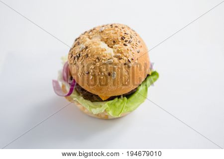 High angle view of hamburger with sesame seed on table