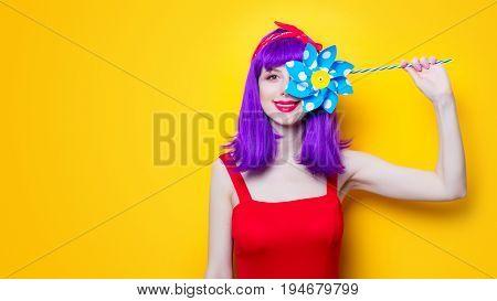 Girl With Pinwheel Toy