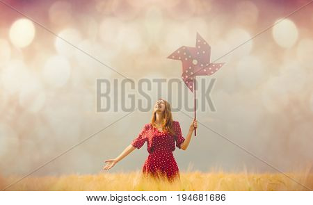 Woman With Pinwheel Toy On Field