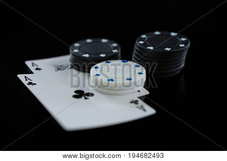 Close-up of chips and aces against white background