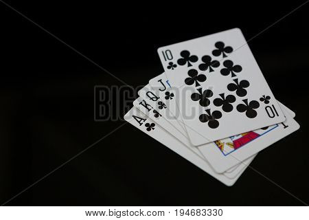 Close-up of clubs cards on black background