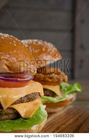 Close-up of hamburgers on chopping board