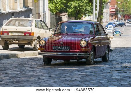Lviv Ukraine - June 4 2017: Old retro car Volkswagen with its owner and au unknown passenger taking participation in race Leopolis grand prix 2017 Ukraine.