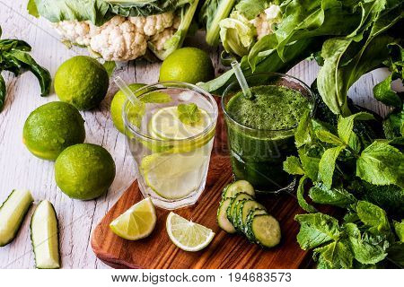 Green Smoothie And Detox Water With Lime, Mint And Ice On Wooden Background. Detox Diet.