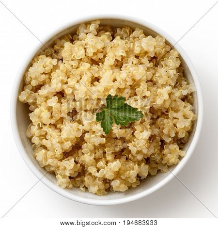 Cooked Quinoa In White Ceramic Bowl Isolated On White From Above With Green Parsley.