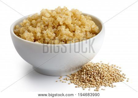 Cooked Quinoa In White Ceramic Bowl Isolated On White. Spilled Uncooked Quinoa.