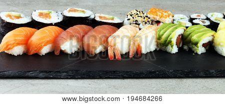 Close Up Of Sashimi Sushi Set With Chopsticks And Soy - Sushi Roll With Salmon And Sushi Roll With S