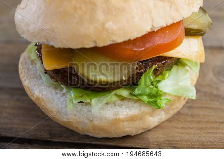 Close-up of hamburger on wooden table