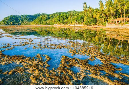 Beautiful morning reflection during low tide, El-Nido, Palawan, Philippines
