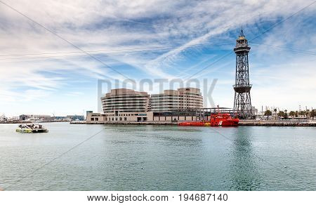 BARCELONA, SPAIN - MAY 2017: Cargo port of Barcelona town with funicular tower