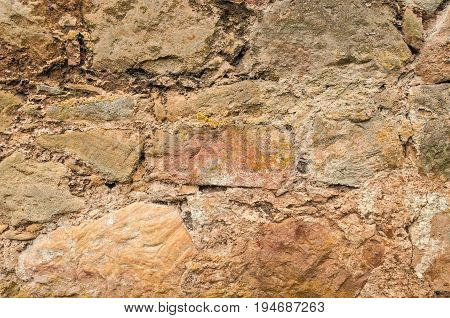 Old Rustic Crumbling Stonewall Background for design