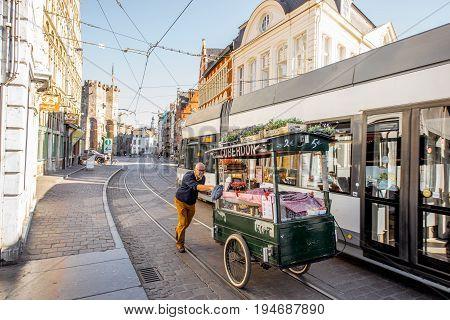 GENT, BELGIUM - June 02, 2017: Man ride a truck with belgian candies called cuberdons on the street in Gent city, Belgium