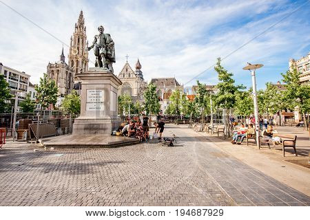 ANTWERPEN, BELGIUM - June 02, 2017: View on the crowded Green square with Rubens statue and church in Antwerpen city, Belgium